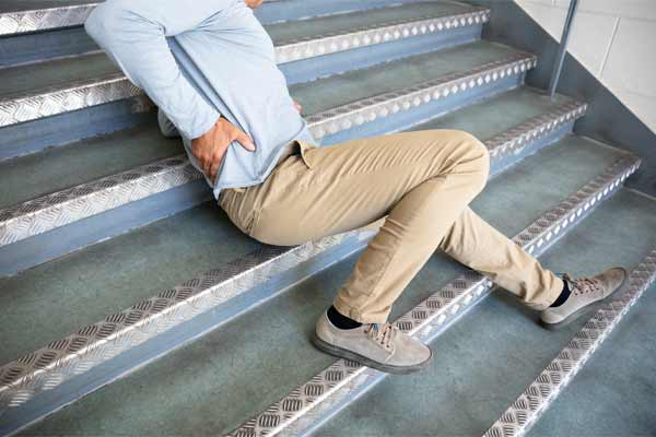 A man with a back injury after falling on a flight of stairs.