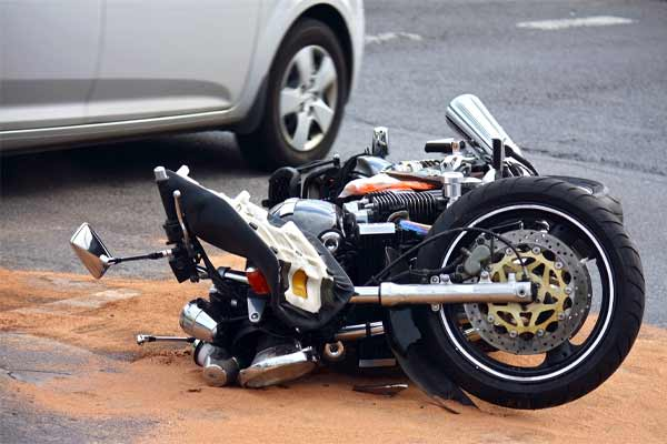 A motorcycle on its side after an accident.